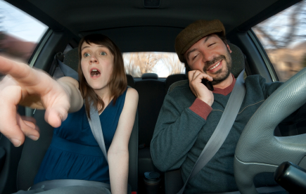 Driving and using a cell phone